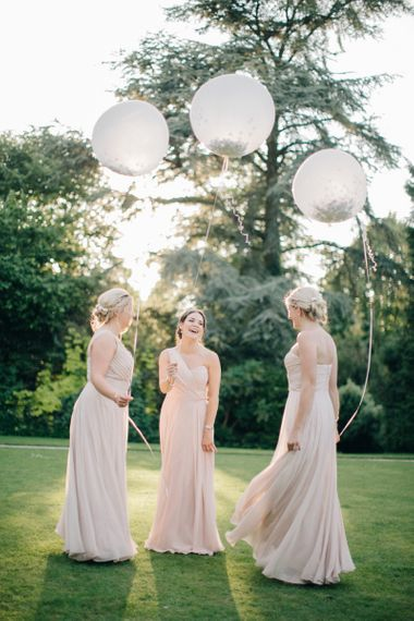 Bridesmaids in Pink Dessy Dresses Holding Giant Confetti Filled Balloons