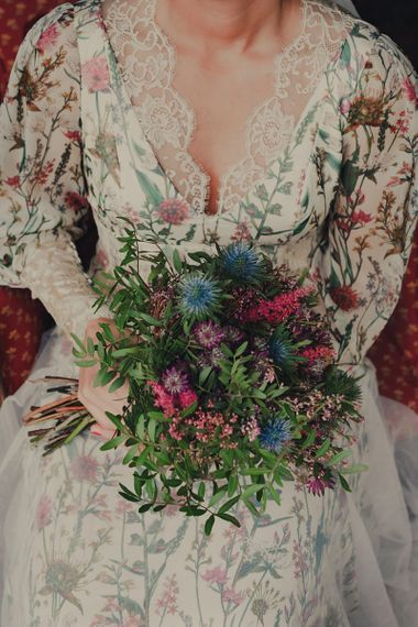 Bride in Floral Print Bespoke Wedding Dress by From Lista With Love Holding Wild Wedding Bouquet