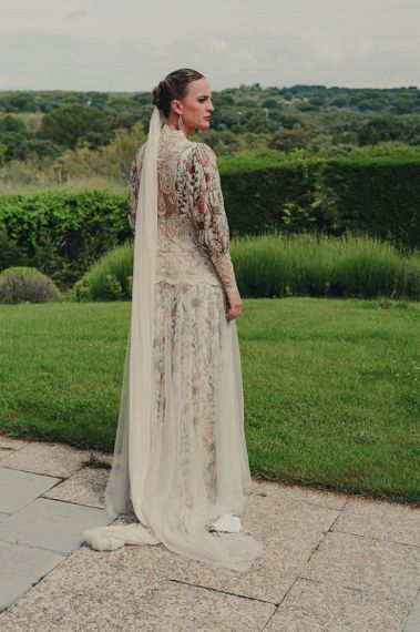 Bride in Floral Print Bespoke Wedding Dress by From Lista With Love with Long Wedding Veil