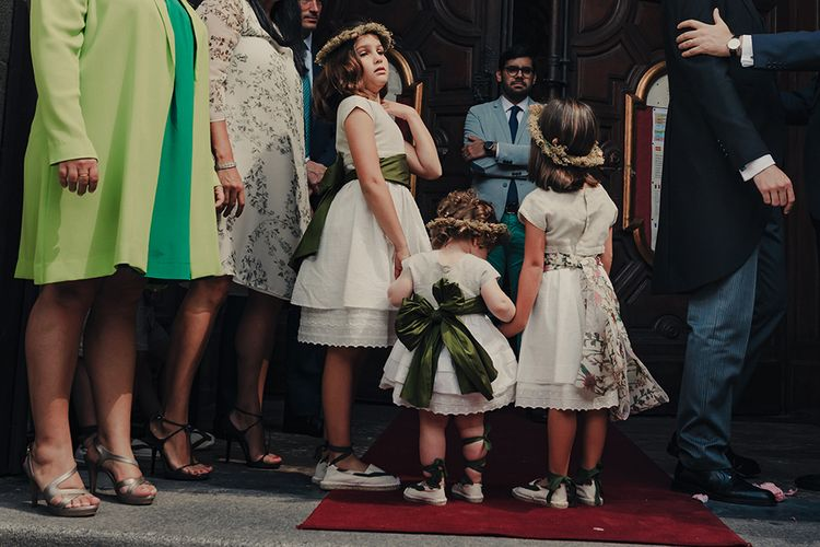Flower Girls in White Dresses with Emerald Green and Floral Print Bows and Flower Crowns