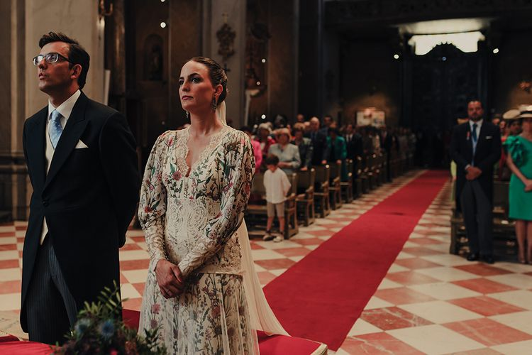 Spanish Church Wedding Ceremony with Bride in Floral Print Bespoke Wedding Dress by From Lista With Love and Groom in Tails