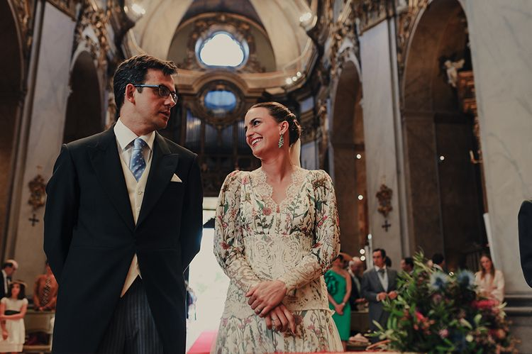 Spanish Church Wedding Ceremony with Bride in Floral Print Bespoke Wedding Dress by From Lista With Love and Groom in Traditional Morning Suit