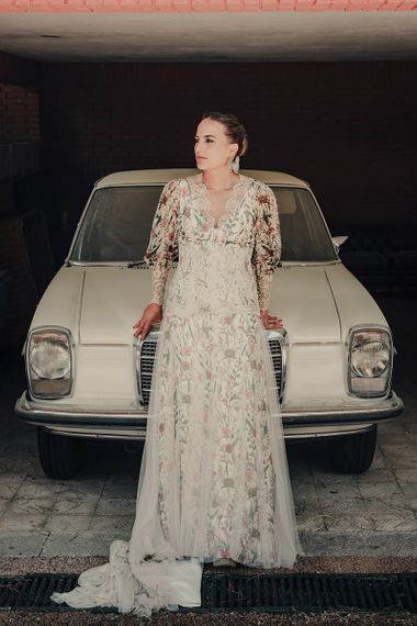 Bride in Floral Print Bespoke Wedding Dress by From Lista With Love Standing in Front of Wedding Car