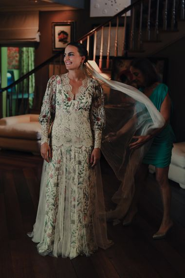 Bride in Floral Print Bespoke Wedding Dress by From Lista With Love Having Her Veil Adjusted