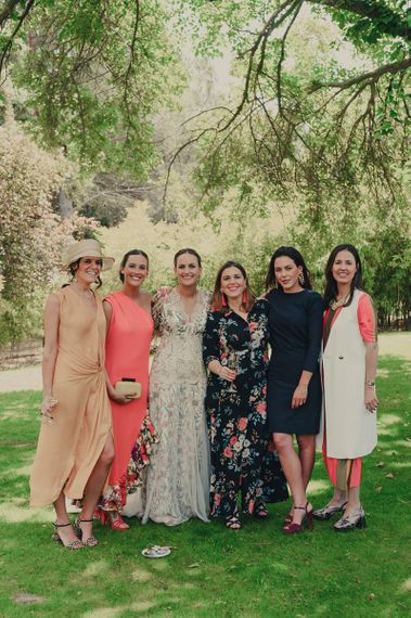 Bride in Floral Print Bespoke Wedding Dress by From Lista With Love  with Wedding Guests