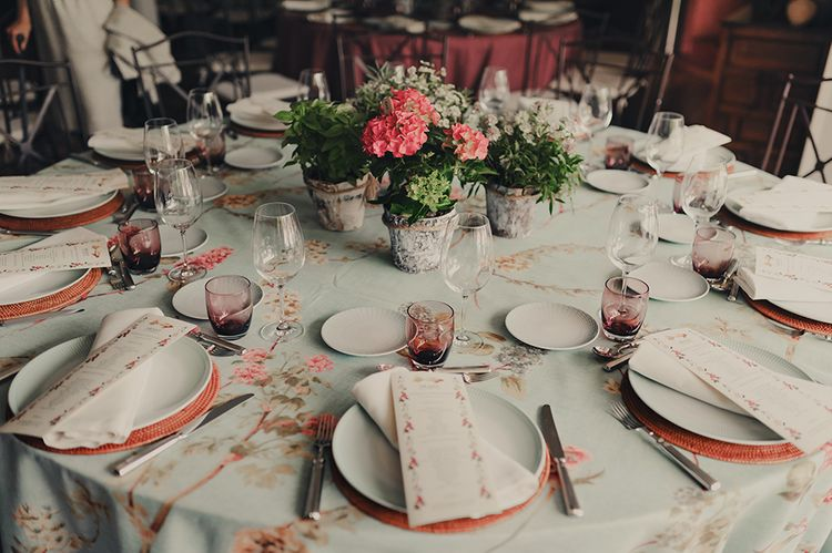 Wedding Table Decor with Floral Table Cloth, Pink Charger Plates and Floral Centrepiece