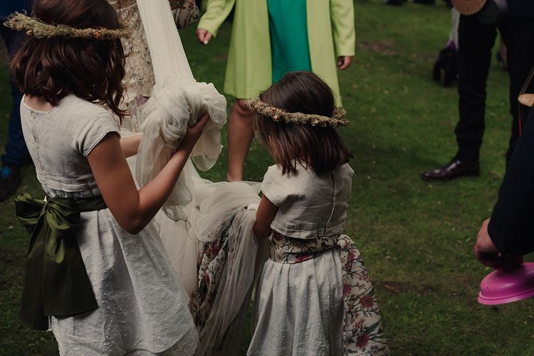 Flower Girls Playing with the Brides Wedding Veil