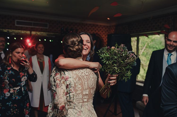 Bride and Wedding Guest Embracing