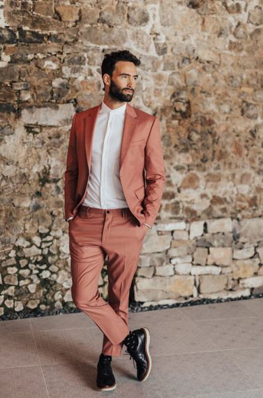 Groom in Coral Wedding Suit with Grandad Collar White Shirt