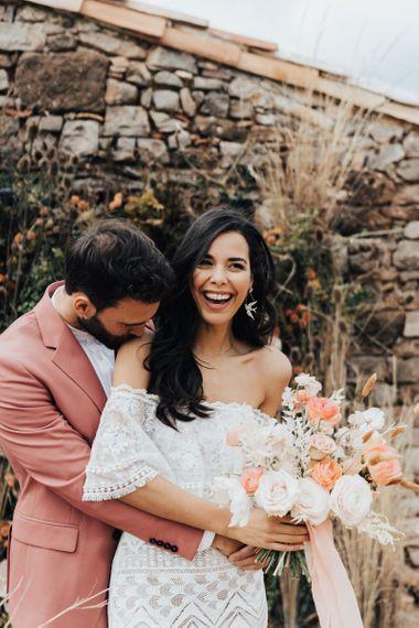Groom Kissing his Brides Should in Bardot Wedding Dress