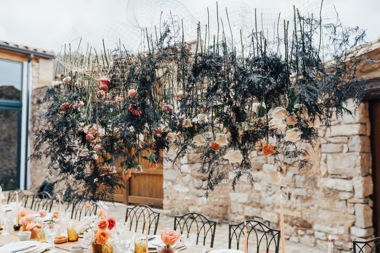 Hanging Flower Stems and Foliage Over Wedding Reception Table