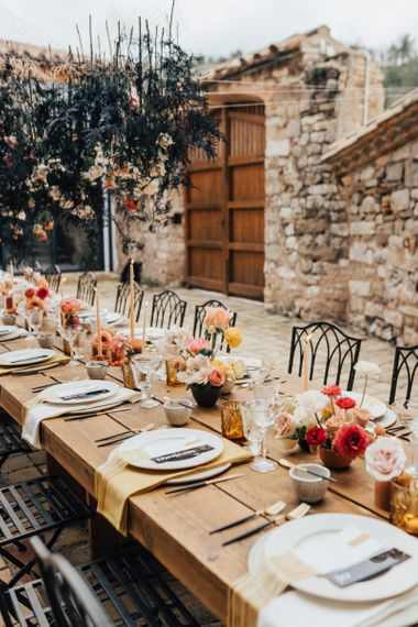 Rustic Wedding Reception Table with Living Coral Flowers and Contemporary Decoration