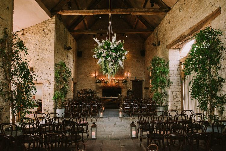 Giant hanging floral display at ceremony in Cripps Barn
