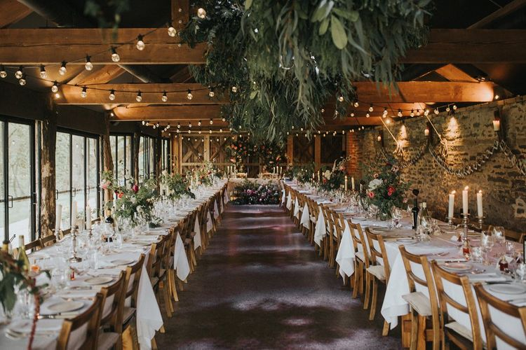 Rustic Reception at Dewsall Court Barn Wedding Venue with Floral Decor