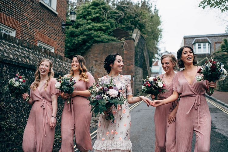 Bridesmaids In Pink Jumpsuits // Beautiful DIY Village Hall Wedding For Under £5k // Guests Made Food // Bride Wears Needle & Thread // Images By Dale Weeks Photography