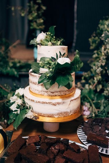 Semi Naked Wedding Cake // Beautiful DIY Village Hall Wedding For Under £5k // Guests Made Food // Bride Wears Needle & Thread // Images By Dale Weeks Photography