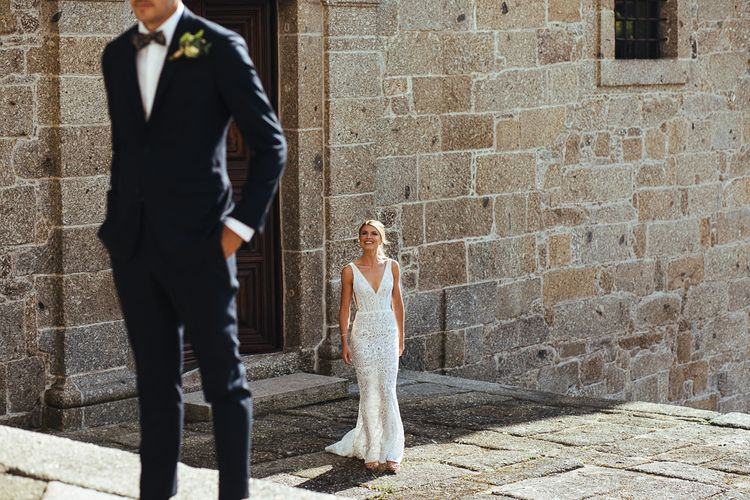 First Look with Bride in Pallas Couture Esila Wedding Dress Approaching Her Groom in a Monokel Tuxedo