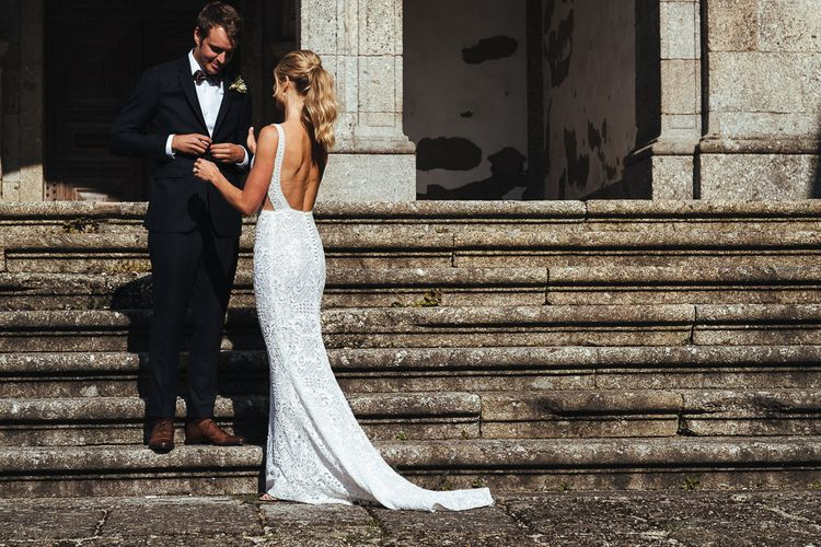 Bride in Pallas Couture Esila Wedding Dress and  Groom in a Monokel Tuxedo Meeting at First Look