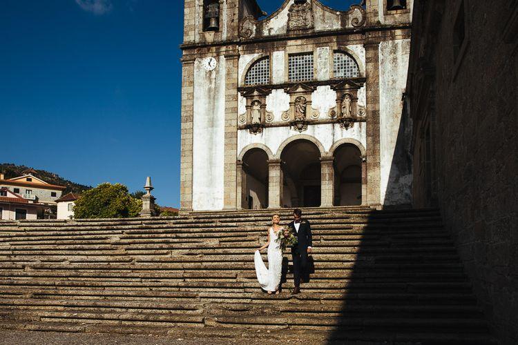 Bride in Pallas Couture Esila Wedding Dress and  Groom in a Monokel Black Tie Suit