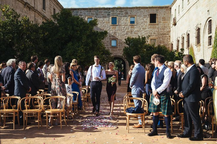 Groomsman & Bridesmaid Walking Down The Aisle at Outdoor Wedding Ceremony at Former Cisterian Monastery, Pousada de Amares in Portugal