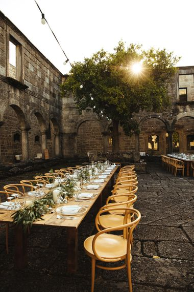Outdoor Wedding Reception with Long Table and Festoon Lights