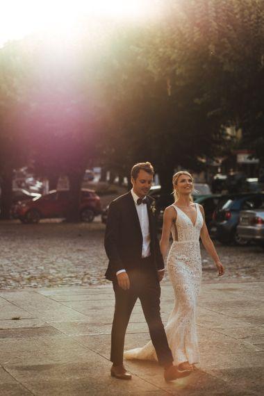 Bride in Pallas Couture Esila Wedding Dress and Groom in a Monokel Tuxedo and Bow Tie