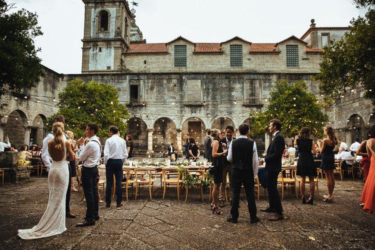 Outdoor Wedding Reception at Former Cisterian Monastery, Pousada de Amares in Portugal with Festoon Lights