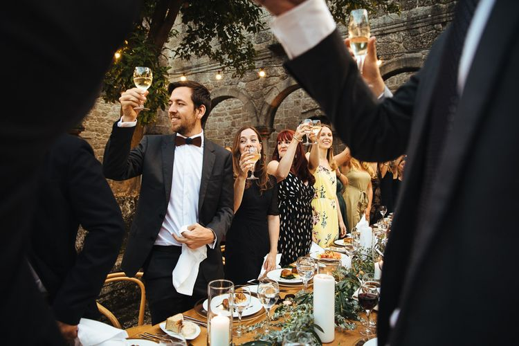 Wedding Guests Raising Their Glasses During Wedding Reception Speeches