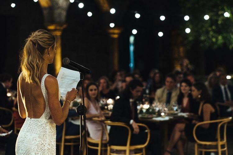 Bride in Pallas Couture Esila Wedding Dress Giving a Wedding Speech