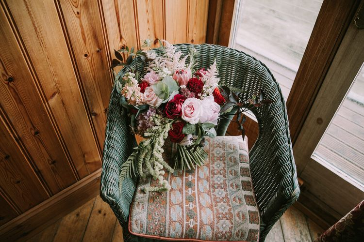 Bridal Bouquet of Burgundy and Blush Flowers with Foliage | Mykonos Rewritten Bridesmaid Dresses for an Epic Clifftop Coastal Wedding | Nic Ford Photography