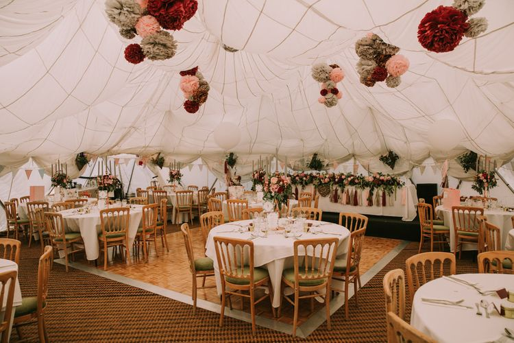 Marquee with Draped Ceiling at The Druidstone | Grey, Blush and Burgundy Pom Poms | Top Table Runner of Blush and Burgundy Flowers with Foliage | Pastel Bunting | Grey Tapered Candles | Rose Gold Candelabras | Giant White Balloons with Grey, Blush and Burgundy Tassels | Table Centrepieces of Blush and Burgundy Flowers with Foliage | Mykonos Rewritten Bridesmaid Dresses for an Epic Clifftop Coastal Wedding | Nic Ford Photography