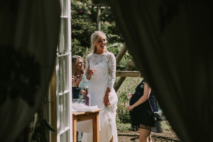 Bride in Grace Loves Lace Inca Gown with Boat Neck, Lace Sleeves and Low Back | Wedding Reception at The Druidstone | Mykonos Rewritten Bridesmaid Dresses for an Epic Clifftop Coastal Wedding | Nic Ford Photography