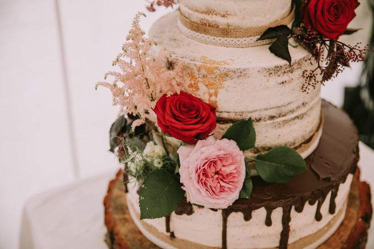 Three-Tier Semi-Naked Wedding Cake with Chocolate Drippy Icing, Gold Leaf, Hessian Ribbon and Red Roses | Mykonos Rewritten Bridesmaid Dresses for an Epic Clifftop Coastal Wedding | Nic Ford Photography
