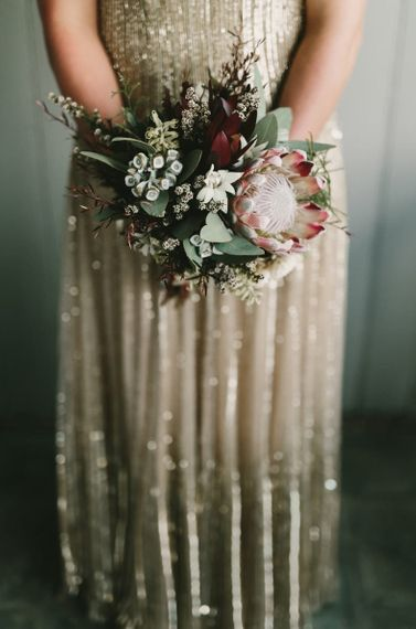 Bride in Gold Wedding Dress Holding King Protea Wedding Bouquet