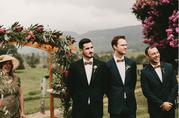 Groomsmen at the Altar in Dark Suits and Wooden Bow Ties