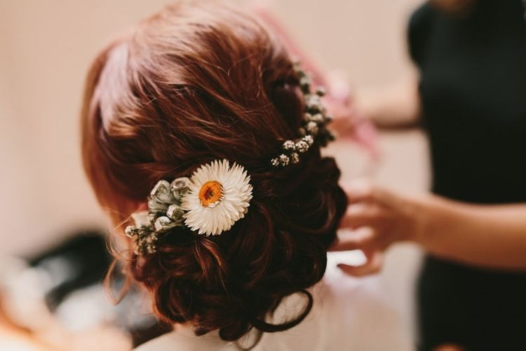 Pinned Bridal Up Do with Fresh Flowers in Her Hair