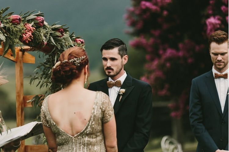 Bride and Groom Saying Their Vows at an Outdoor Wedding Ceremony