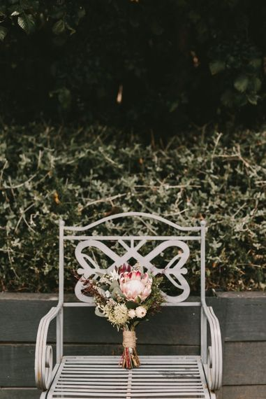 King Protea Bridal Bouquet Sitting on Garden Chair