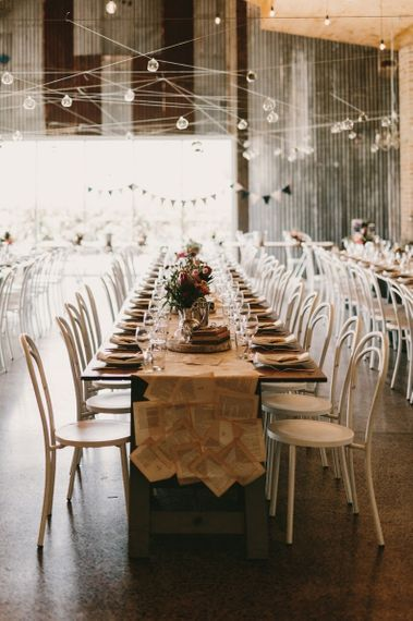 Wedding Reception Decor with Festoon Lights, Book Pages Table Runner and Tree Slice Centrepieces