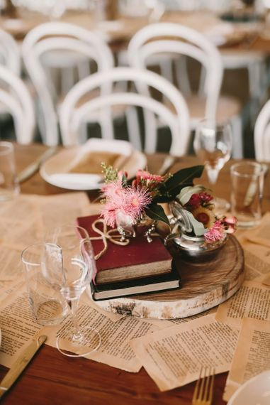 Tree Slice Centrepiece with Antique Books and Pink Flowers in Vase