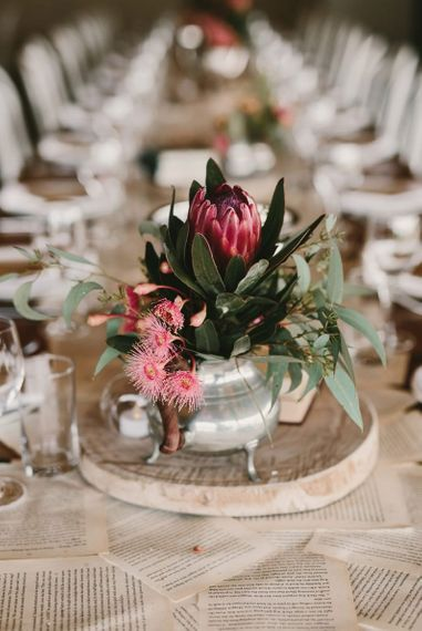 Pink Flowers in Silver Vessel on Tree Slice as Table Centrepiece