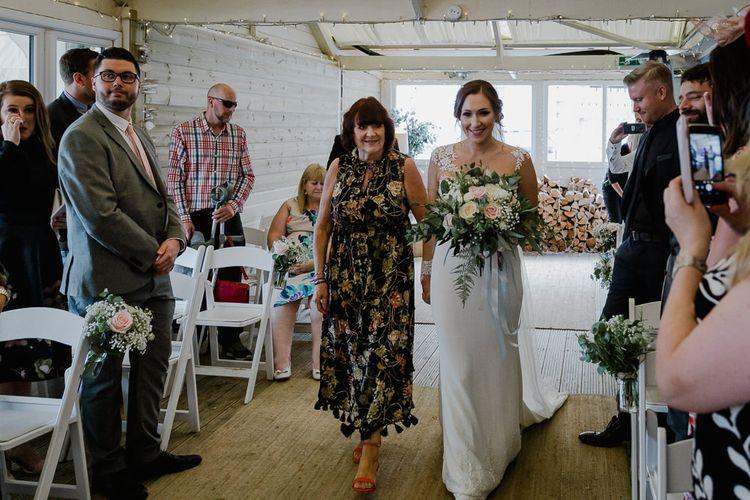 Wedding Ceremony Bridal Entrance in Long Sleeve Lace Martina Liana Wedding Dress Escorted by Mother-of-the-Bride | Lusty Glaze Beach Wedding Newquay Cornwall | Alexa Poppe Photography