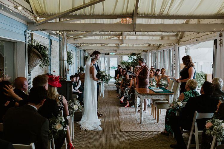 Wedding Ceremony | Bride in Lace Long Sleeve Martina Liana Wedding Dress | Groom in Navy Three-piece Suit | Lusty Glaze Beach Wedding Newquay Cornwall | Alexa Poppe PhotographyLusty Glaze Beach Wedding Newquay Cornwall | Alexa Poppe Photography