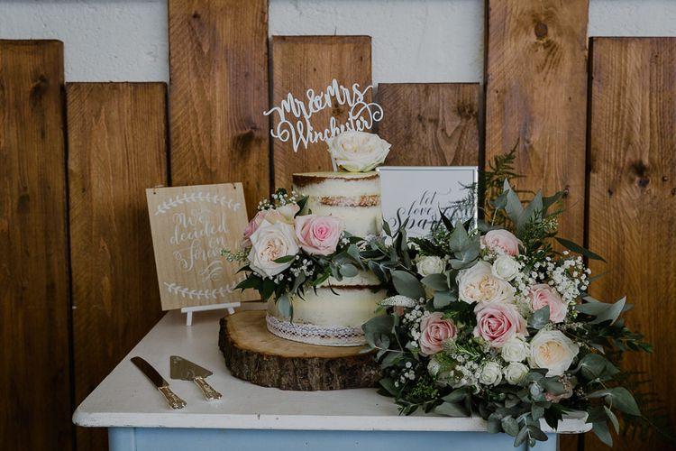 Semi Naked Wedding Cake on Tree Slice Cake Stand | Lusty Glaze Beach Wedding Newquay Cornwall | Alexa Poppe Photography
