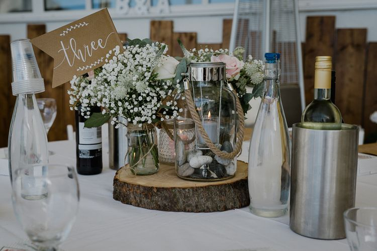 Tree Slice & Flowers in Jars Table Centrepiece | Wedding Decor | Lusty Glaze Beach Wedding Newquay Cornwall | Alexa Poppe Photography