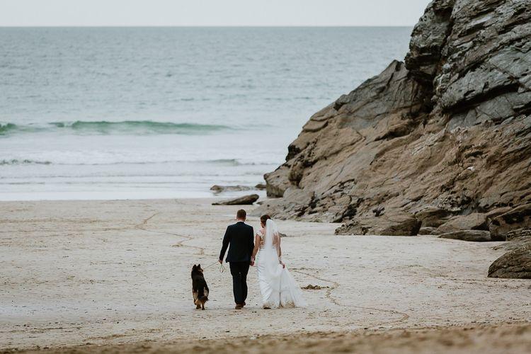 Coastal Portrait | Bride in Lace Long Sleeve Martina Liana Wedding Dress | Groom in Navy Three-piece Suit | Lusty Glaze Beach Wedding Newquay Cornwall | Alexa Poppe PhotographyLusty Glaze Beach Wedding Newquay Cornwall | Alexa Poppe Photography
