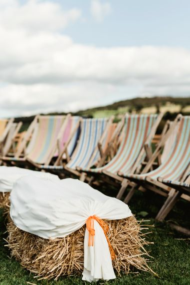Outdoor Wedding Ceremony | Haybales | Deck Chairs | Colourful Outdoor Ceremony and Marquee Reception at Braisty Estate in North Yorkshire | The Lou's Photography