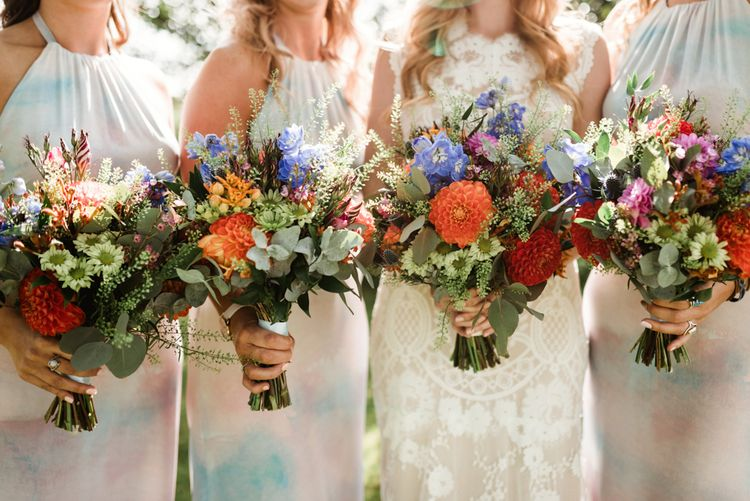 Colourful Wild Flower Bouquet | Bride in Claire Pettibone Wedding Dress | Colourful Outdoor Ceremony and Marquee Reception at Braisty Estate in North Yorkshire | The Lou's Photography