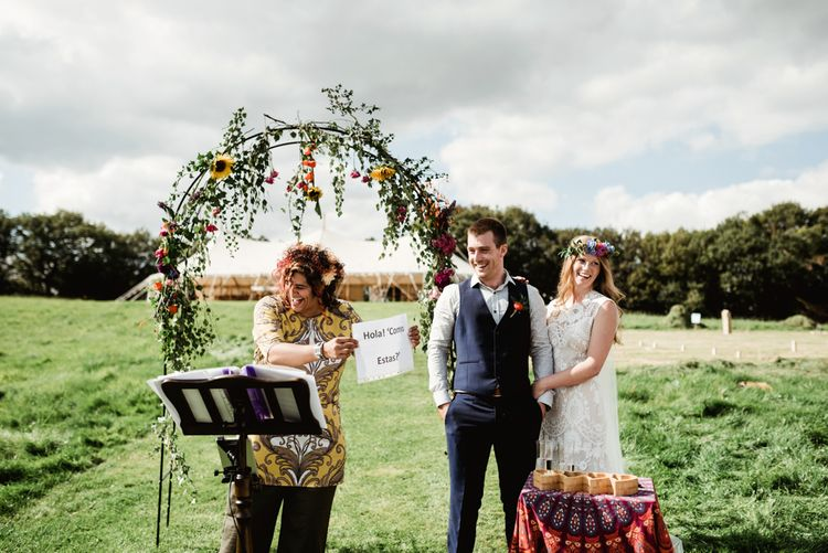 Outdoor Wedding Ceremony | Wild Flower Arch | Bride in Claire Pettibone Gown | Groom in Waistcoat | Colourful Outdoor Ceremony and Marquee Reception at Braisty Estate in North Yorkshire | The Lou's Photography