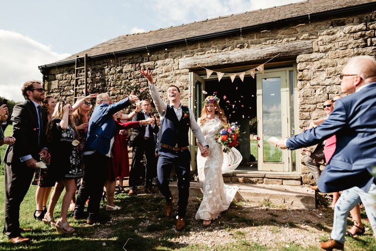 Confetti moment | Bride in Claire Pettibone Wedding Dress | Groom in Waistcoat | Colourful Outdoor Ceremony and Marquee Reception at Braisty Estate in North Yorkshire | The Lou's Photography